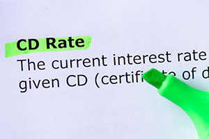 Green highliter over a paper with the word CD rate highlighted
